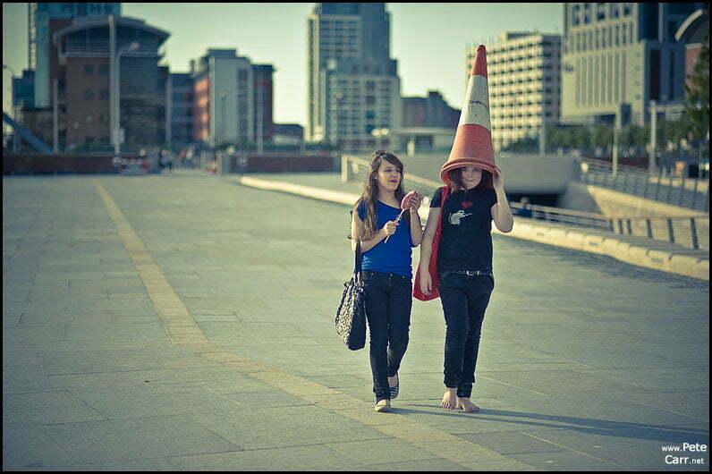 Girl wearing a traffic cone